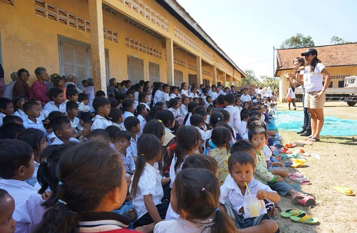 One Hundred Pounds of Hope Founder Amanda Prak Sam speaks to villagers during a January 2014 trip to Cambodia.