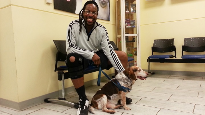 Michael Verner, a client of the Richmond SPCA's Clinic for Compassionate Care, with his dog Oliver